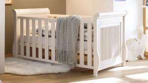 Babybett HELSINKI aus Kiefer massiv in weiß inkl. Lattenrost